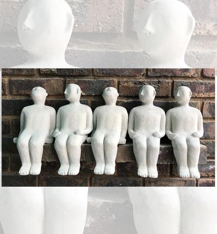 MIA-Men-sitting-on-wall